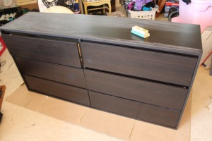 Plain black Ikea Dresser sanded with high grit sand paper.